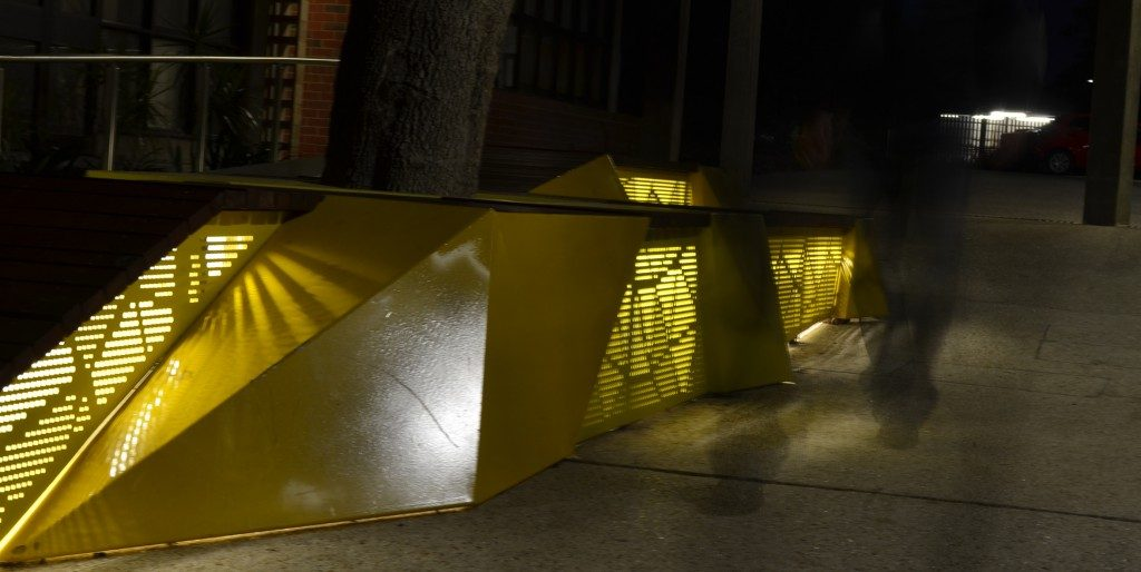 The seating element lights the walkway at night time.